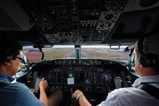 Cockpit view of pilots landing a plane