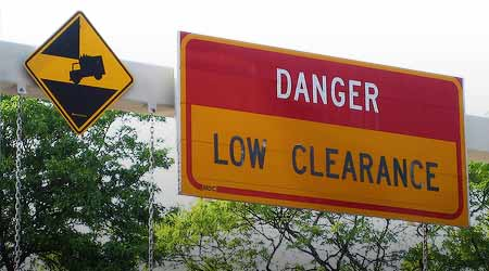 Highway sign: DANGER LOW CLEARANCE
